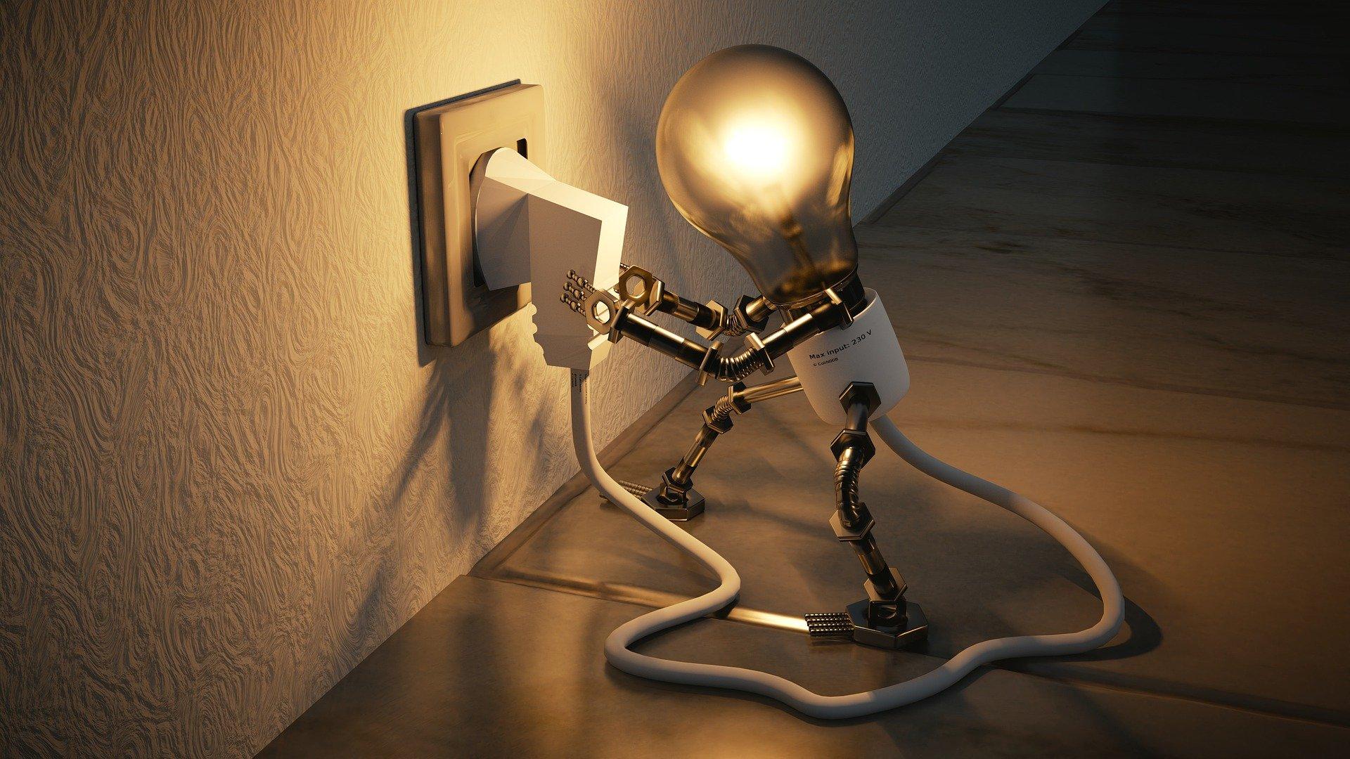 imagen de bombilla conectado un enchufe electrico en pared
